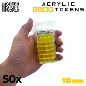 Gelbe kubische Spielmarken